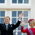 King and Queen greet the people after their ride in the golden cariage
