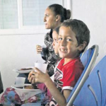 Kids enjoying the movie and their snacks at the Eugenius Johnson Centre (Photo The Daily Herald)