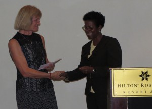 Transition Coordinator Angela Dekker (left) receives, on behalf of RCN / OCW, the official confirmation of membership from the hands of Estellita Rene of CANTA.