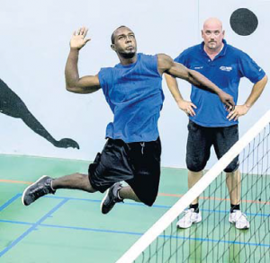 Jovan Robinson delivers a smash as Thomas Zorn looks on. The Saba 2015 Volleyball is set to conclude with two matches at St. John's Gym Saturday. (Photo by Scott Kirkpatrick.)