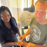Historical Museum guide Misha Spanner (left) handing over the fragments to archaeologist Joost Morsink, who will bring them to St. Maarten and Saba.