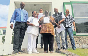 From left: Acting Island Governor Franklin Wilson, Doloria Wilson (receiving the certificate for her son Jean Curtis Wilson), Daniel Tejeda de Los Santos, Rovita Weeks, Jevon Weeks and EOS Programme Leader Ginno Romero.