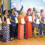Saba Reach's adult students proudly showing their language course certificates.