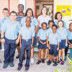 Sacred Heart School Principal Diane Wilson (left), new teachers Femke Neunzig (centre) and Selma Neel (right) with a group of pupils ready to get their day started.