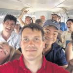 Aviation journalist Adam Twidell takes a selfie as the international journalists brought in by Princess Juliana International Airport SXM approach Saba.