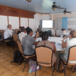 Ms. Bayer-Bowen of CXC during the information session with the participants; all school directors of  St. Eustatius,  Education personnel from Saba, the Transition Coordinator, some external education specialists and Windward Islands representatives of RCN/Education, Culture and Science.  (Photo RCN)