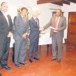 """Commissioner of Constitutional Affairs Reginald Zaandam (right) presenting the 'Gin House Declaration"""" to Minister of Home Affairs and Kingdom Relations Ronald Plasterk, with from left, Commissioners Clark  Abraham (Bonaire) and Christopher Johnson (Saba)."""