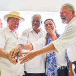 Cutting the ribbon at Saba Heritage Center are, from left: Tourism Director Glenn Holm, Commissioner Chris Johnson, historian Will Johnson, Father Simon Wilson, Corinne Hofman (Leiden University) and Jay Haviser (SABARC). (Bastiaan Janssens photo)
