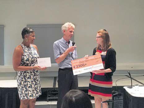 Caroline Teeuwen and Child Focus Project Leader Stacey Simmons receive the semi-finalist award from Oranje Funds Director Ronald van der Giessen.