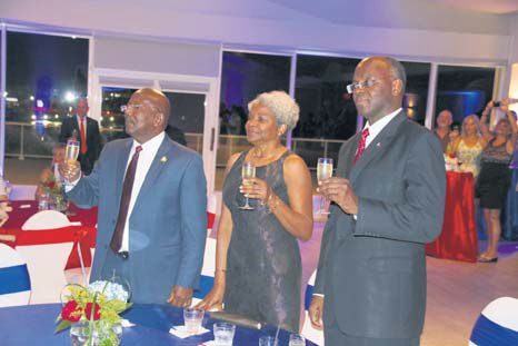 From left: Prime Minister William Marlin, Marie-Louise Holiday and Governor Eugene Holiday toast to the continued success of local airline Winair during its 55th anniversary cocktail reception on Friday. (Andrew Dick photo)