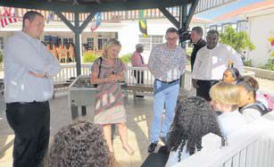 From left: Commissioner of Education Bruce Zagers, Minister of Education Culture and Science Jet Bussemaker and Dutch Government Representative Gilbert Isabella speaking with students on Saba.