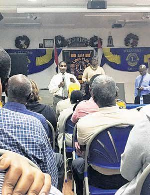 Managing Director Derrick Downes (standing at centre) speaking during the second town hall meeting on the closure of the Saba branch of Windward Islands Bank. (Caribbean Network-Hazel Durand photo)